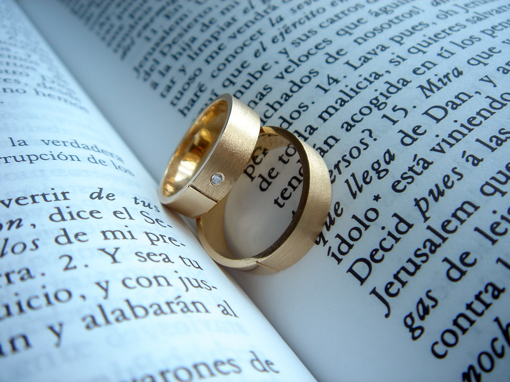 wedding bands on a bible page